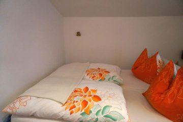 Schlafzimmer Ferienwohnungen in Radstadt – Skigebiet